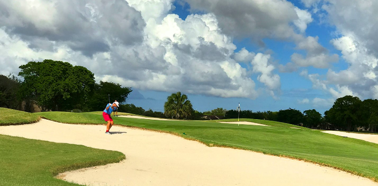 A golfer takes a swing at a ball on the course at Miccosukee Golf & Country Club in Miami